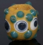 Ancient yellow glass stratified eye bead with prunts