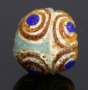 Ancient glass stratified eye bead, Persia